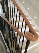 wooden handrail with black metal columns