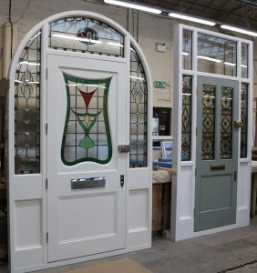White timber front doors with stained glass