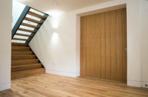 wooden panel door and open staircase