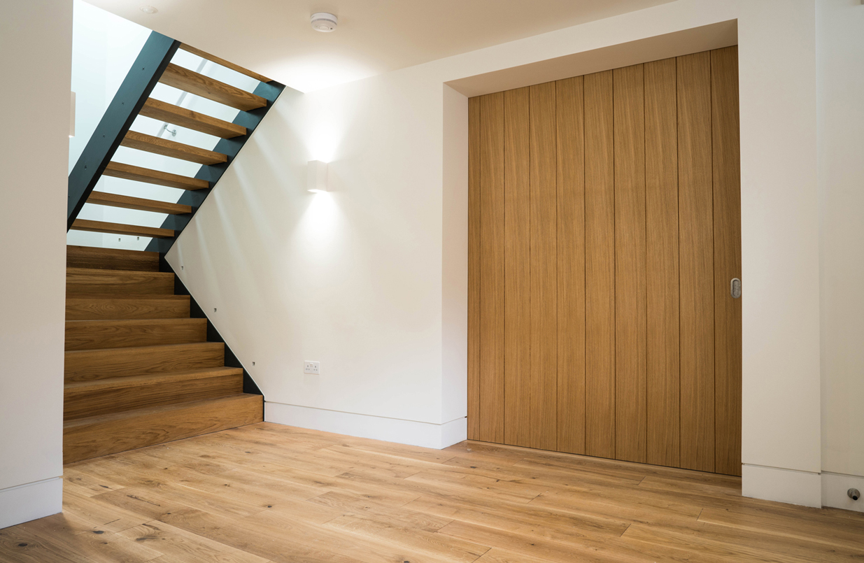 wooden panel door and open staircase