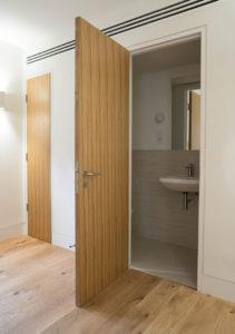 wooden panel bathroom door
