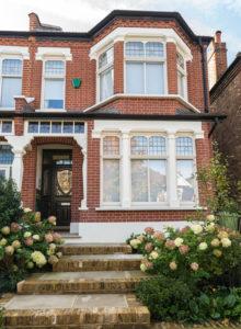 front of house windows and beautiful door
