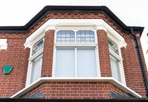 bay window on old brick house
