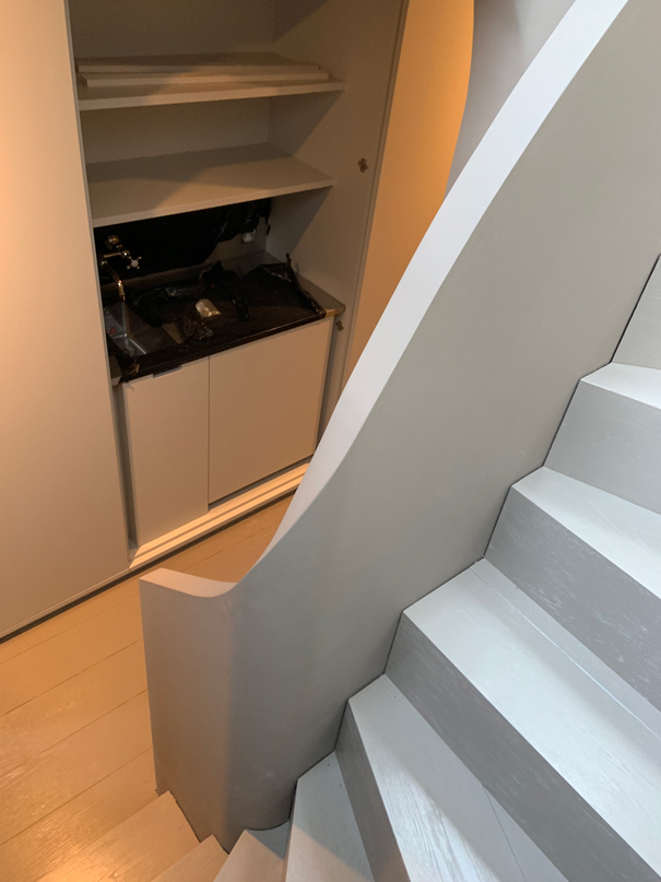 minimal white curved staircase
