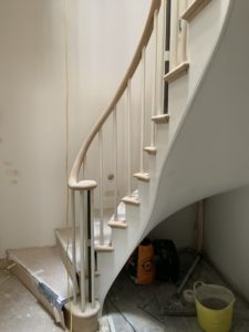 wooden staircase with handrail