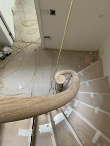 Curled handrail in construction