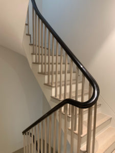 light grey staircase with black bannister