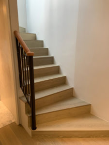 wooden staircase with short bannister