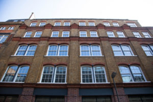 lots of windows on old brick building