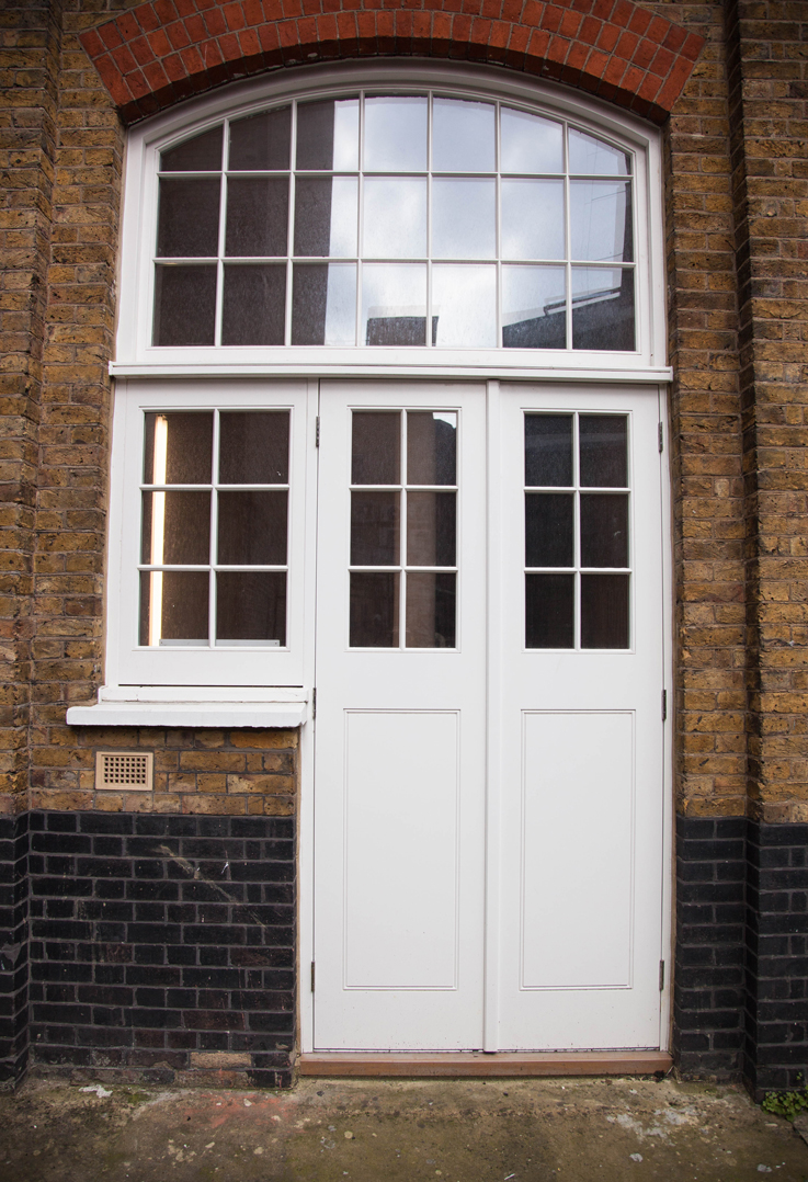 white large door with arch window and side window