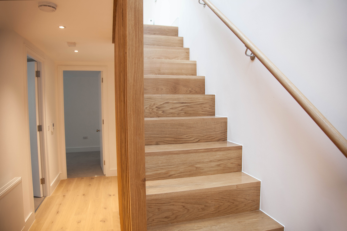wooden staircase with wooden plank bannister
