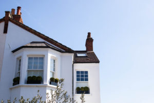 white painted house with beautiful windows outside