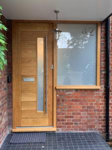 modern wood door with long window and side window