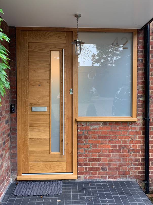 modern wood door with long window and side window