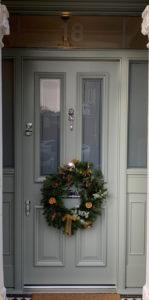 green grey door with christmas wreath