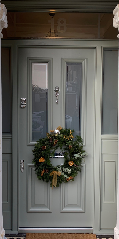 green grey door with christmas wreath