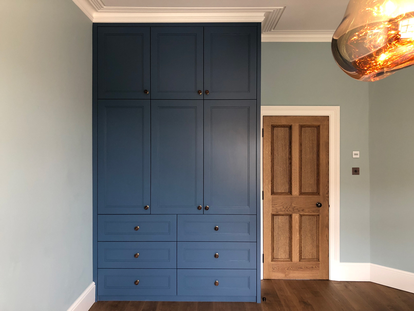 blue full height wardrobe and chest of drawers