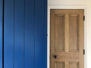 wood door next to blue wardrobe