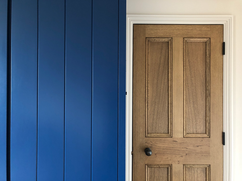 wood door next to blue wardrobe