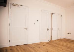 white bifold doors and normal door