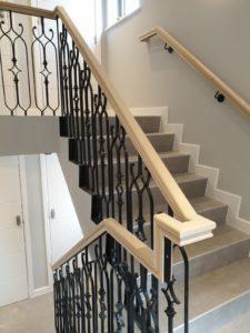 Elegant wooden handrail with metal railings