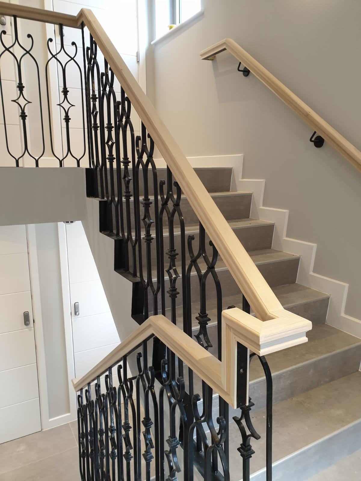 Elegant wooden handrail with metal railings