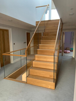 floating open wooden staircase