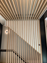 floating open wooden staircase with wood planks