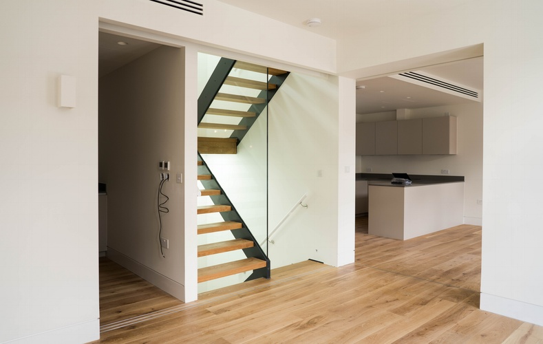 Sliding internal wood doors - Hidden Staircase - Marylebone