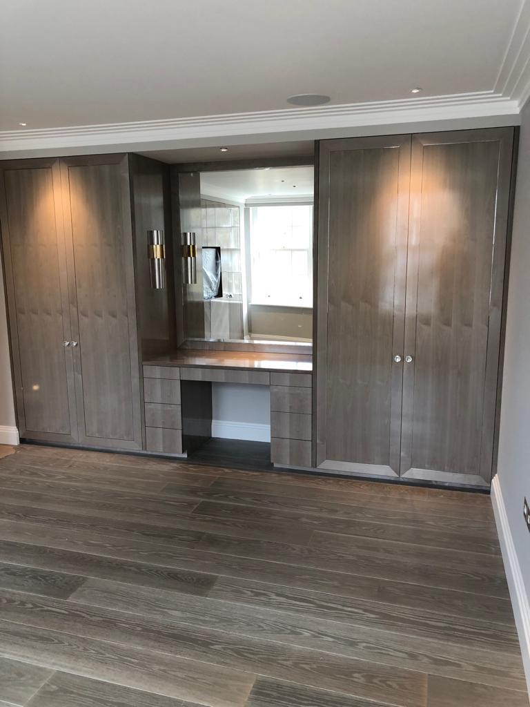 Belgravia bedroom grey wardrobe and mirror cabinetry