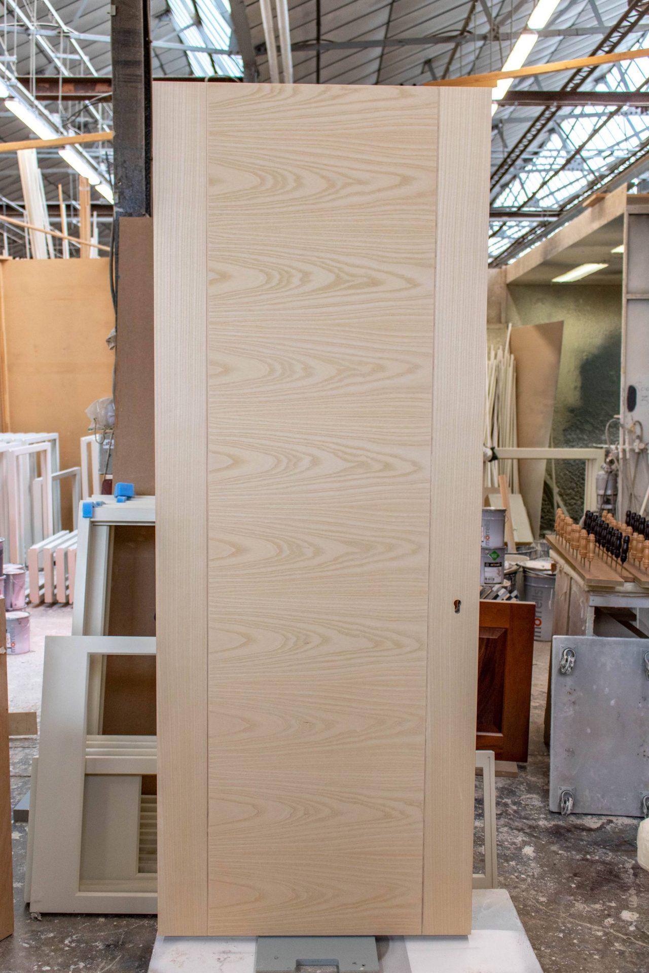 plain wood door in joinery workshop