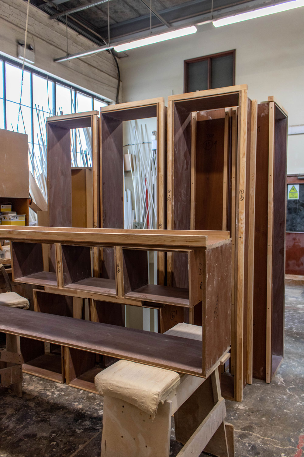 set of wood cabinet frames in joinery workshop
