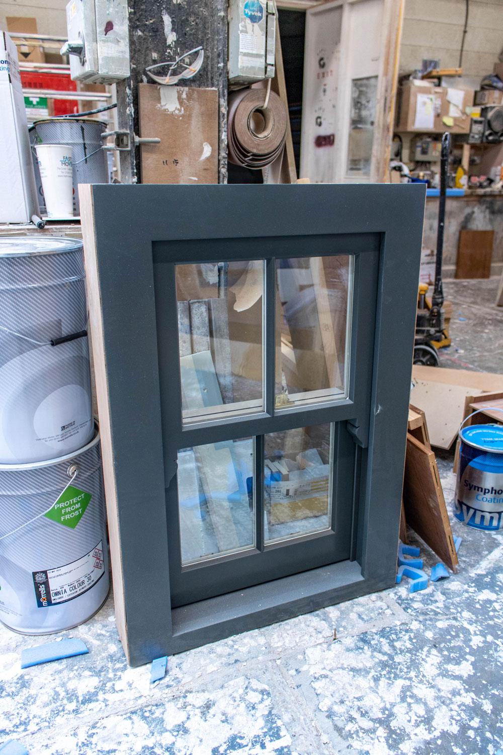 grey sash window in joinery workshop
