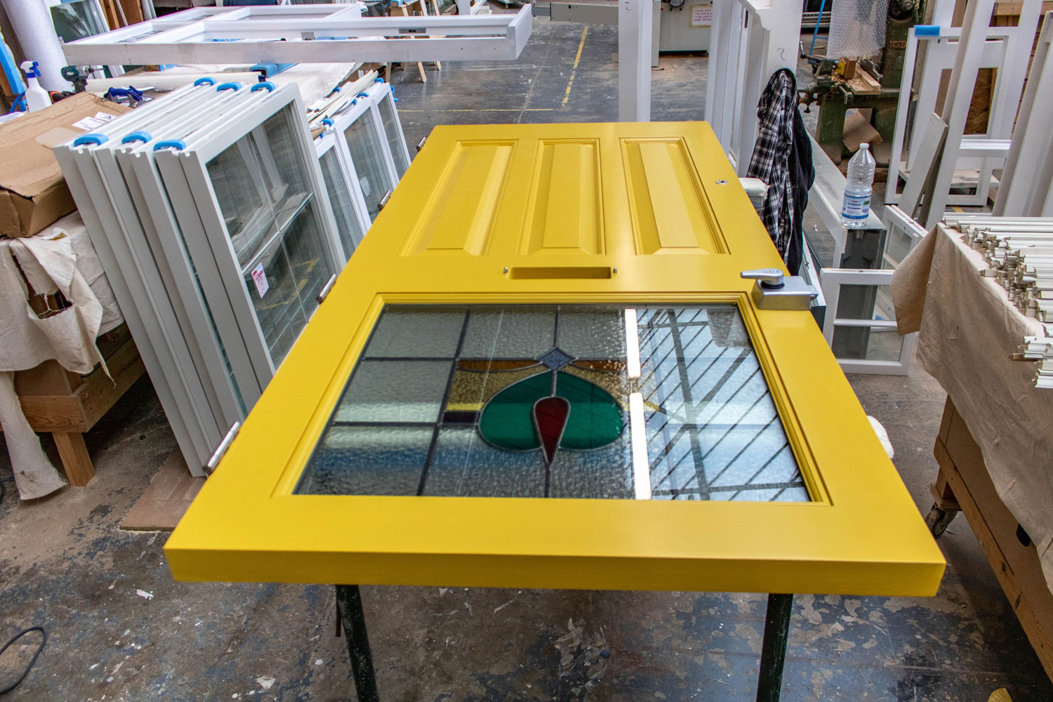 yellow door with stained glass panel