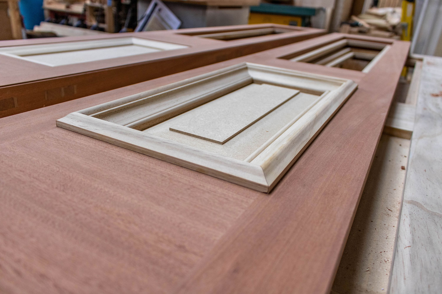 wood door in construction in joinery workshop