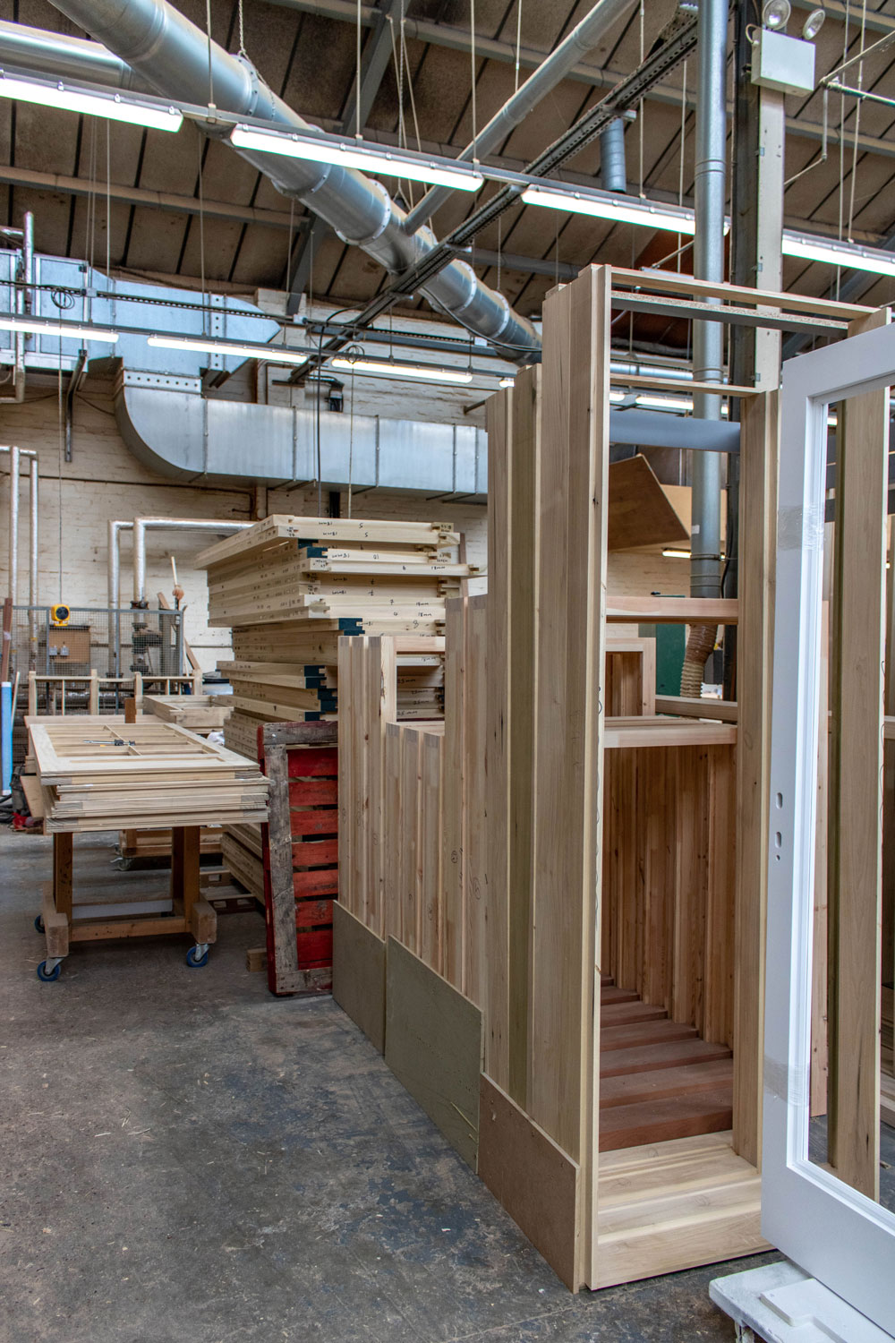 assorted wooden window frames in joinery workshop