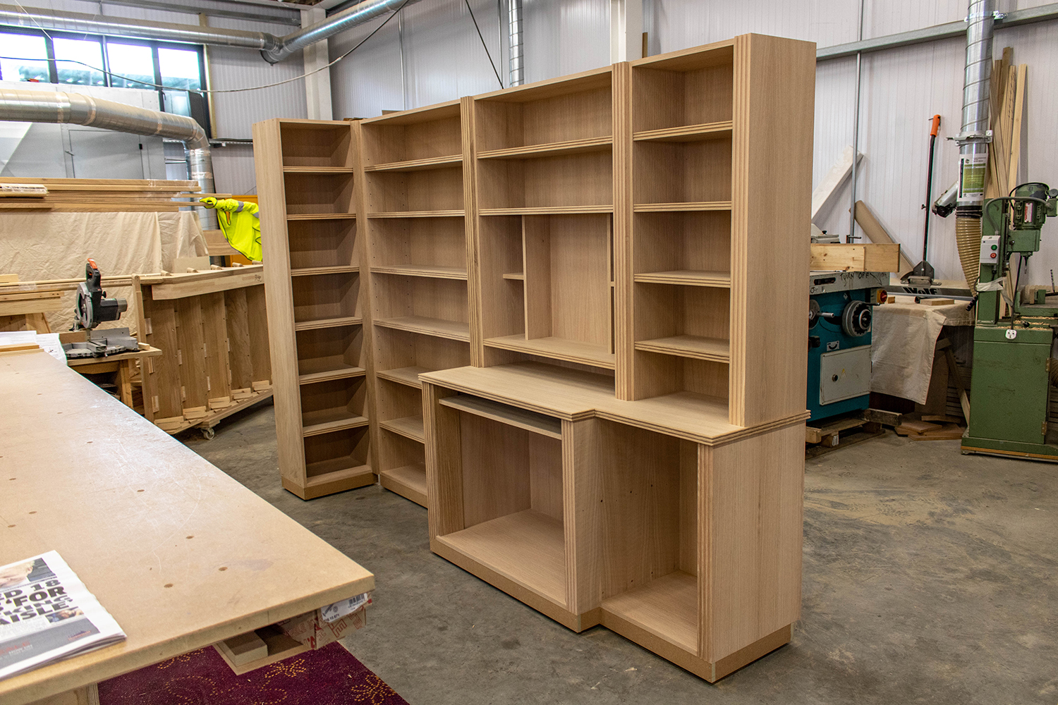 large wood shelving unit in joinery workshop