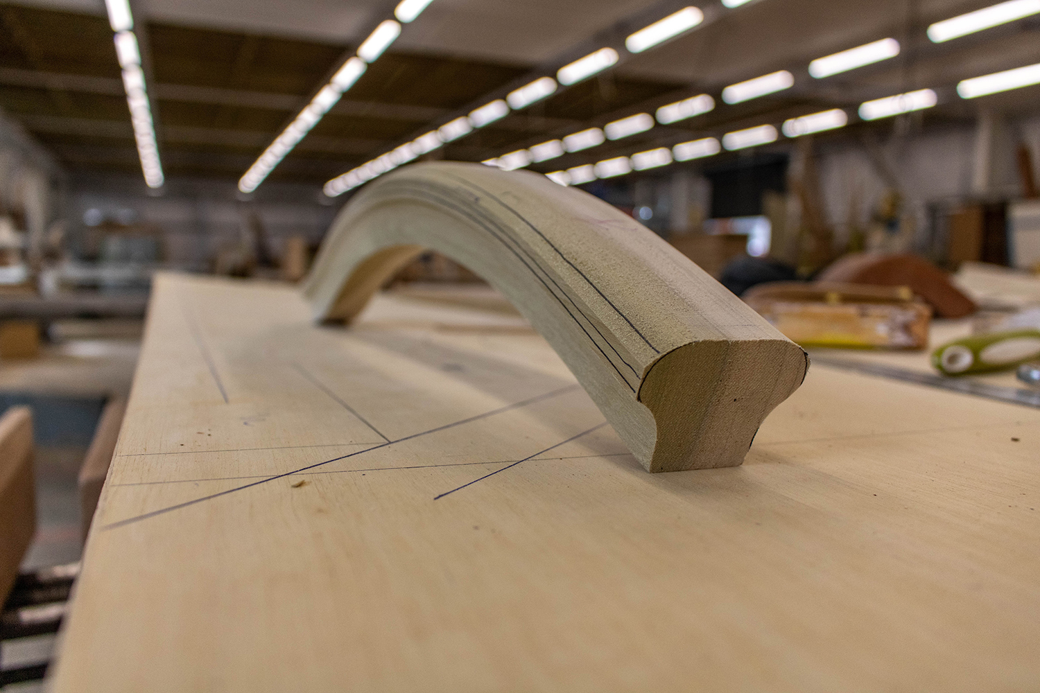 Curved piece of wood in joinery workshop