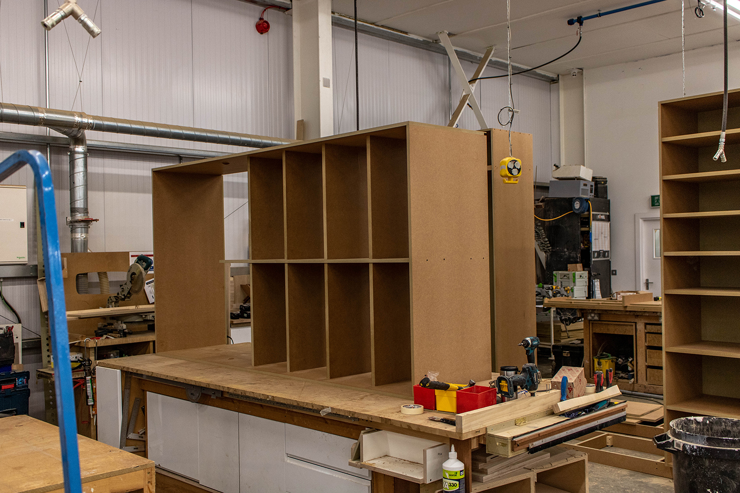 Set of wood shelving in joinery workshop
