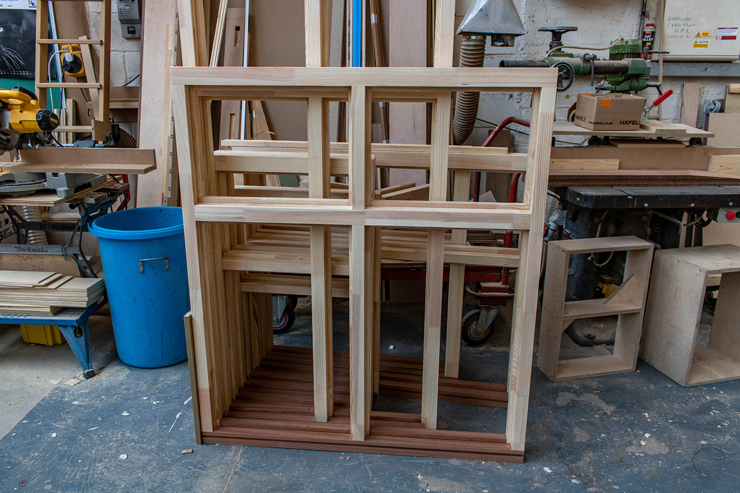 Set of wooden frames for windows in joinery workshop