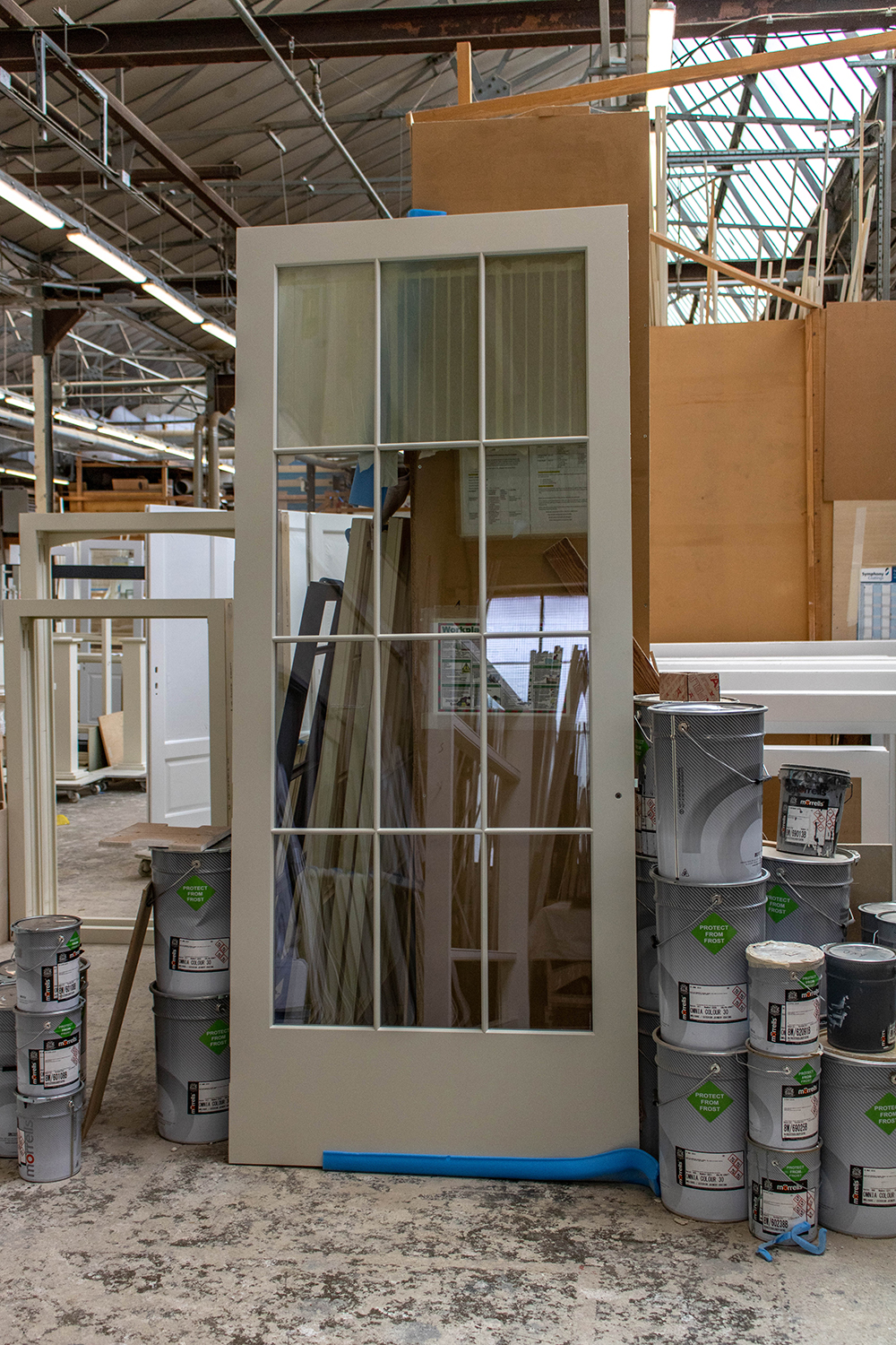 Large grey door with 12 glass panels