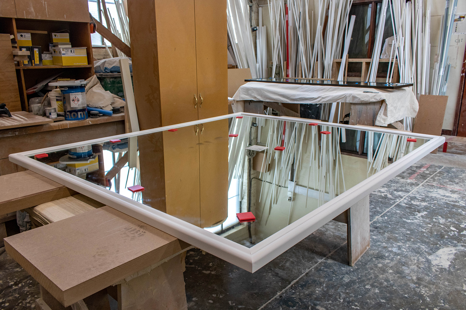 mirror with wood frame construction in joinery workshop
