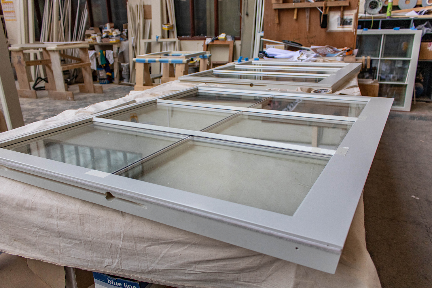 Set of window units in joinery workshop