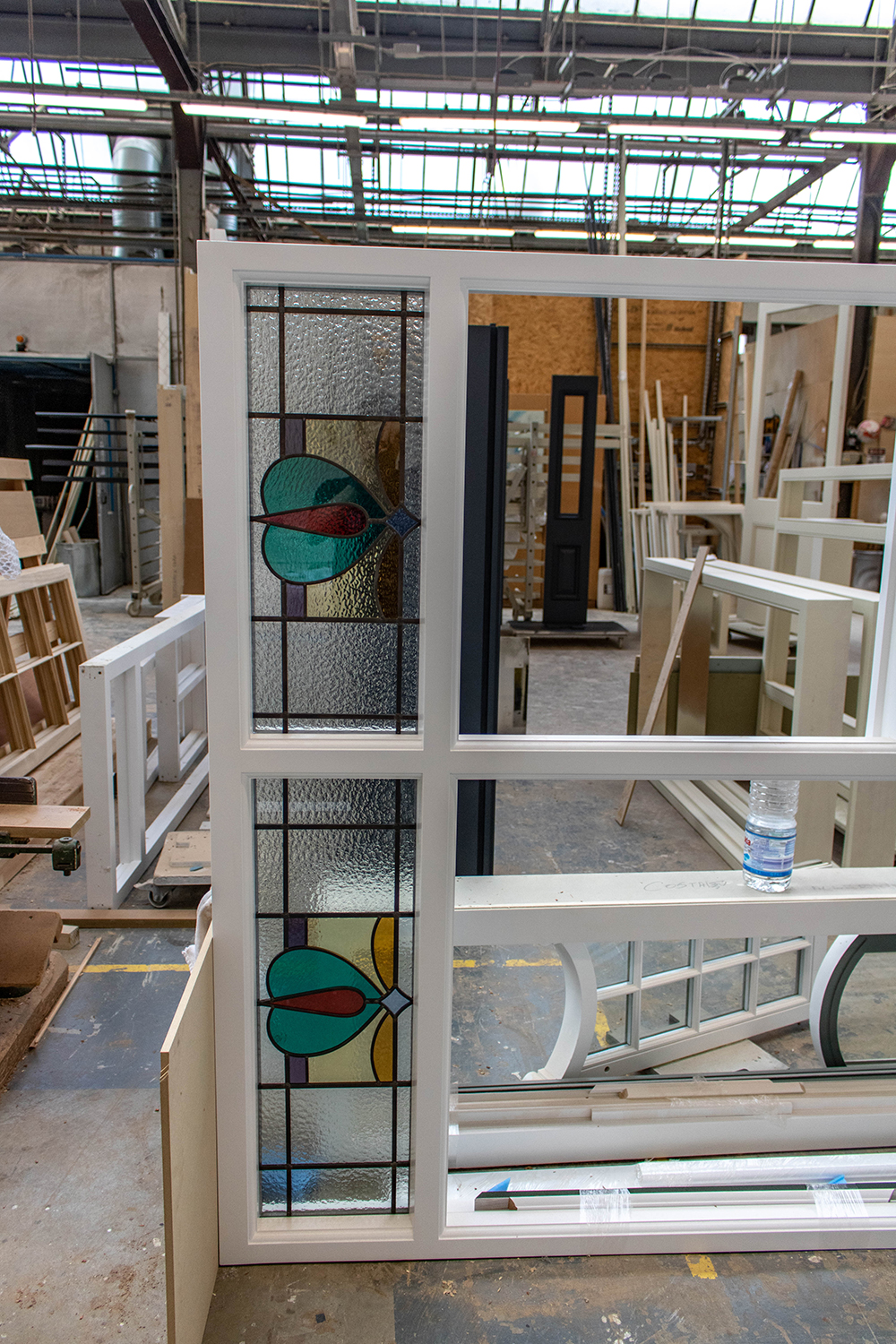 stained glass fanlight assembly in joinery workshop