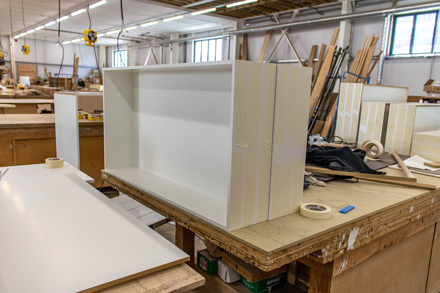 Large white cabinets in joinery workshop