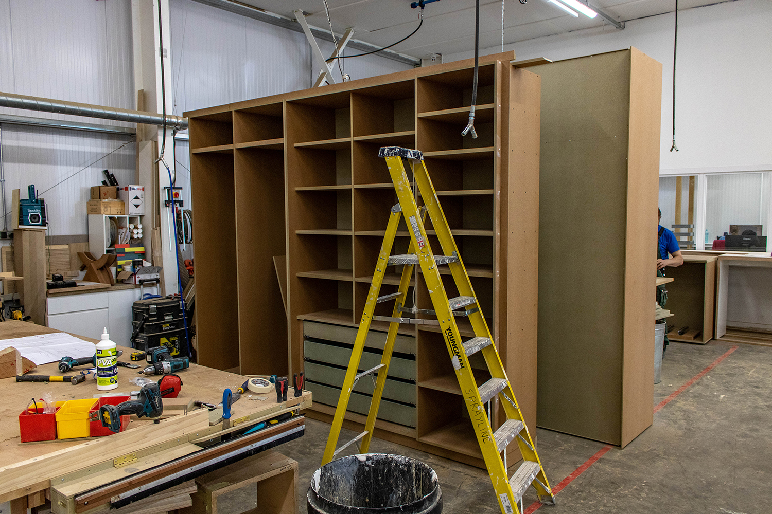 Large modern wardrobe insides and storage in joinery workshop
