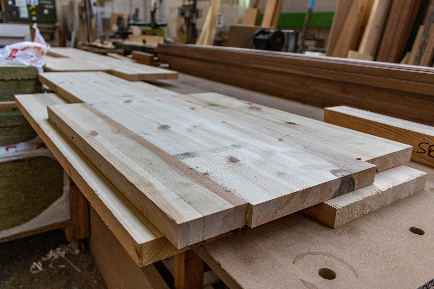 Set of cut wooden planks in joinery workshop