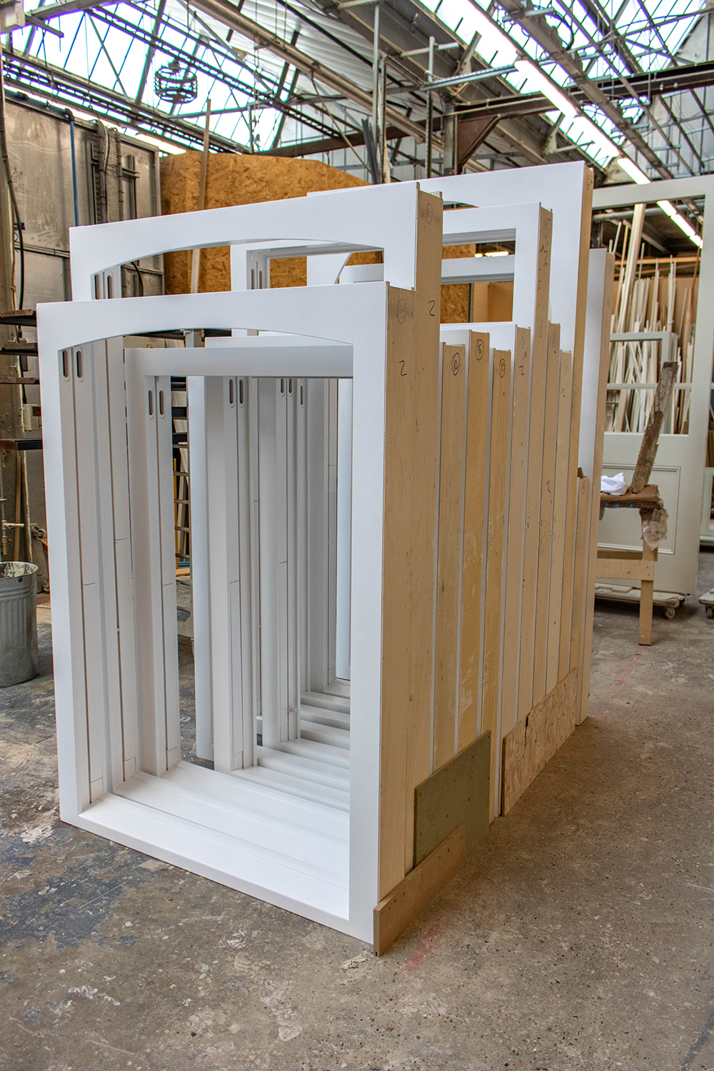 Set of large white window frames in joinery workshop