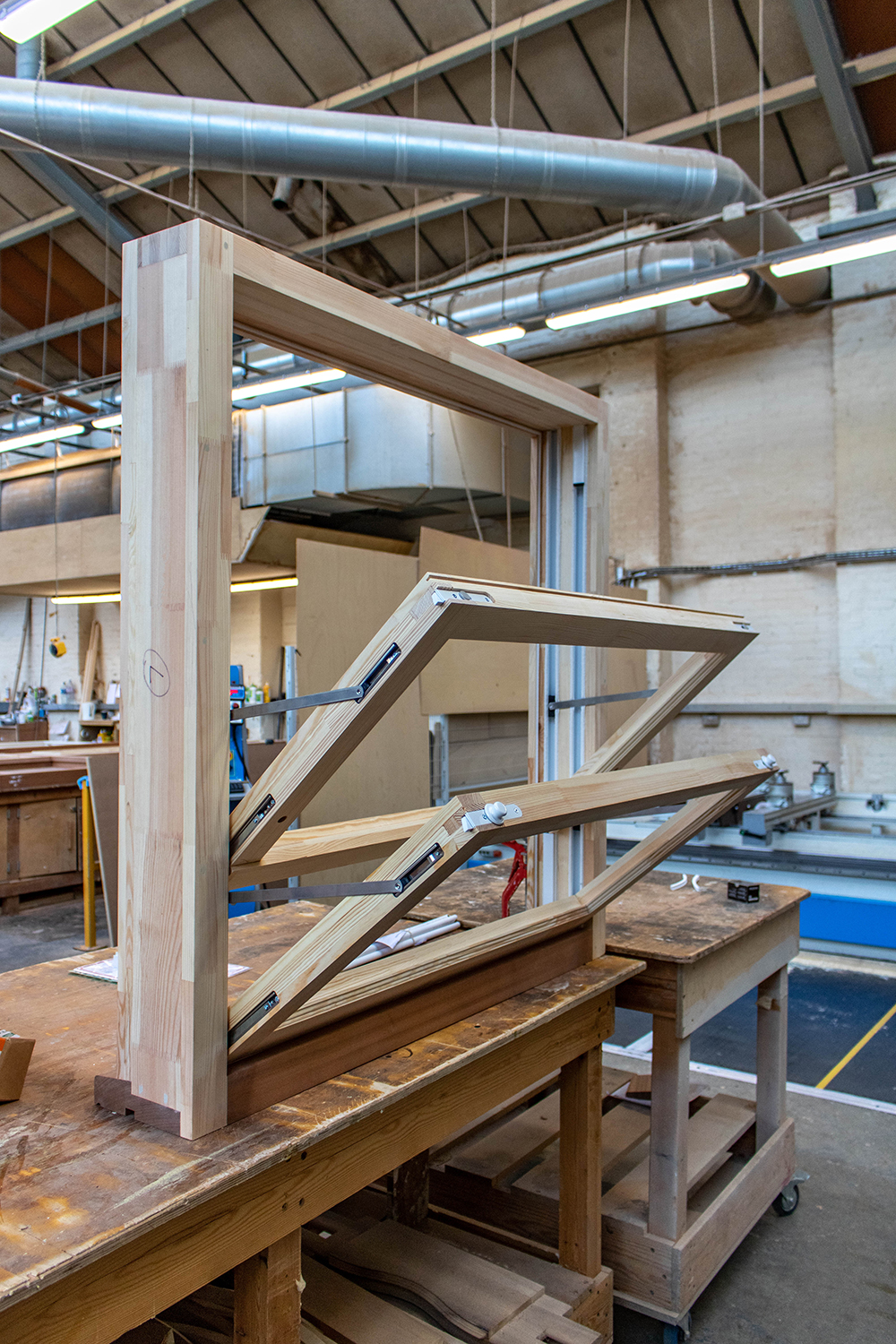 Wood window frame construction in joinery workshop