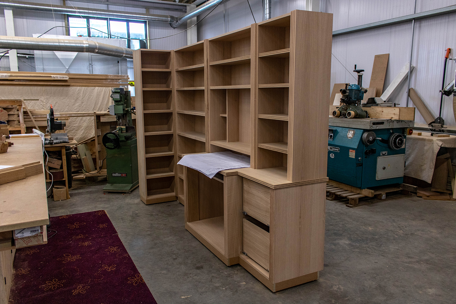 large storage cabinet and shelves in joinery workshop